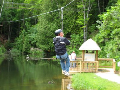 Then for the finale, what I really came for - the zip line. This is something I've wanted to do for awhile. And where else can you experience it for $5? Since I went first, there is no picture of me, but here's Ron!