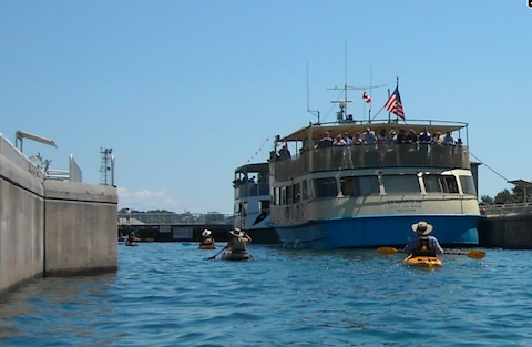 After stopping for lunch, they returned through the locks. This time they entered on the Lake Superior or high side and shared the space with two tour boats
