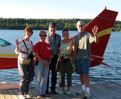 and this evening, some of us flew over it. Here we are excited for our adventure. We went up in a six-seater float plane!