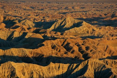 The Borrego badlands turn a great shade of orange just as the sun goes behind the mountain.